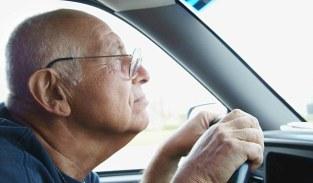 Senior Man Driving --- Image by © Steve Prezant/Corbis